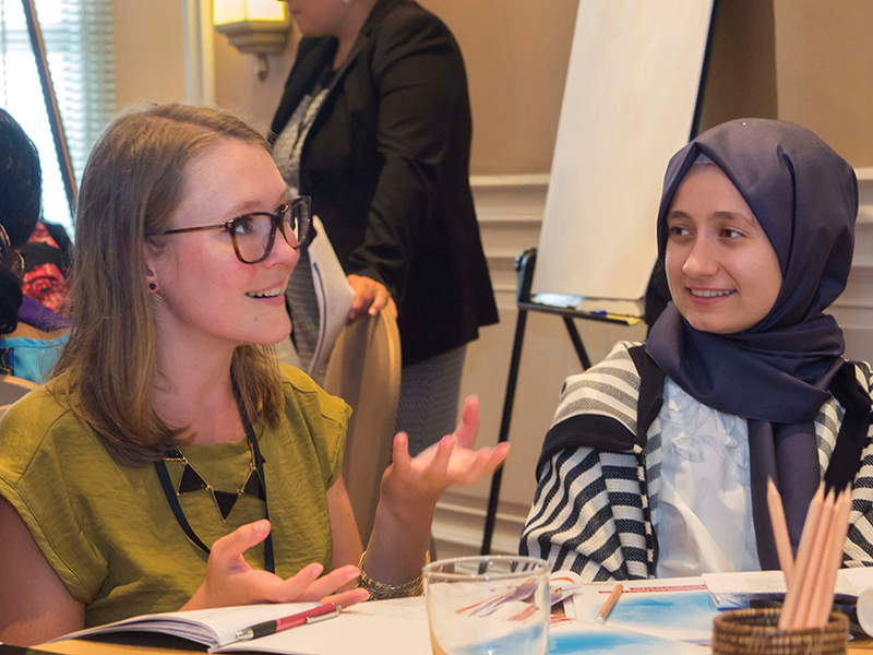 "Afra Feyza Toksal, right with Matilda Dahlquist, from the International Labour Organization in Bangkok, at the recent symposium, ""Cracking the Code."" W.Field/UNESCO"