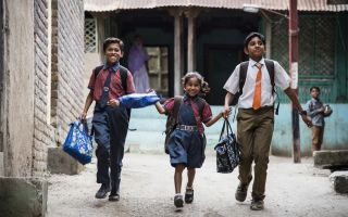 children running to school