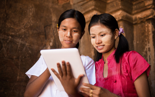 Myanmar girls using a tablet @szefei/shutterstock