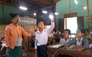 A teacher at Chauk Kan School uses the Eneloop solar lights to teach about energy sources.